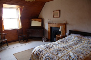 Main double bedroom with views out to Summer Isles